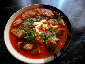 Tomato and baked red pepper puree soup with canned corn